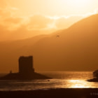 Постер, плакат: Castle Stalker in setting sun