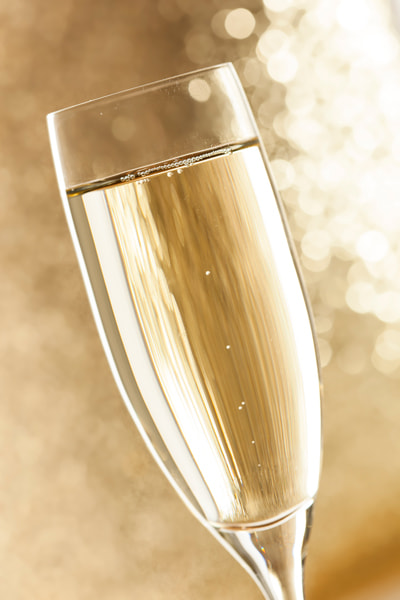 Photograph Bubbling Champagne in a Glass by Brent Hofacker on 500px