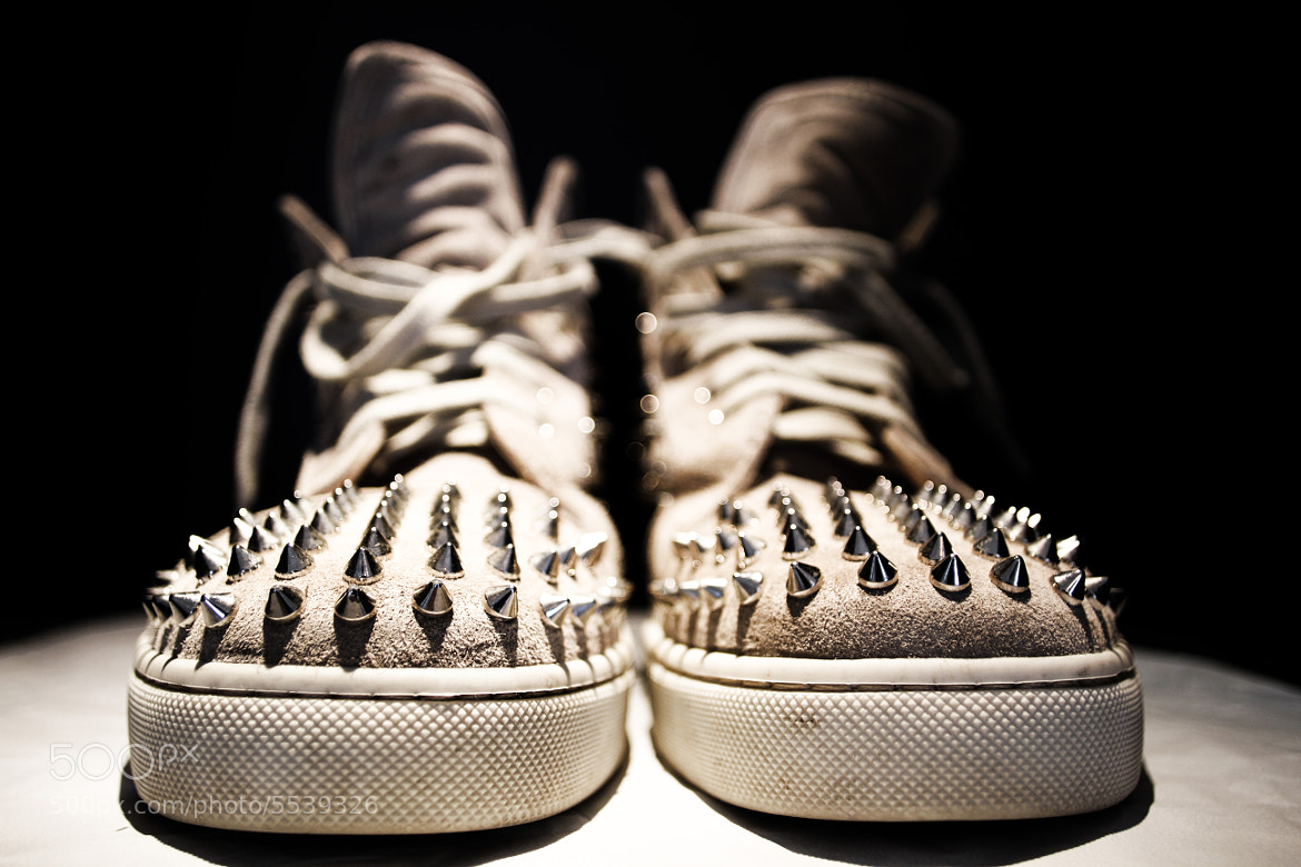 Photograph Christian Louboutin spiked sneakers by Gabriel  Lovas on 500px