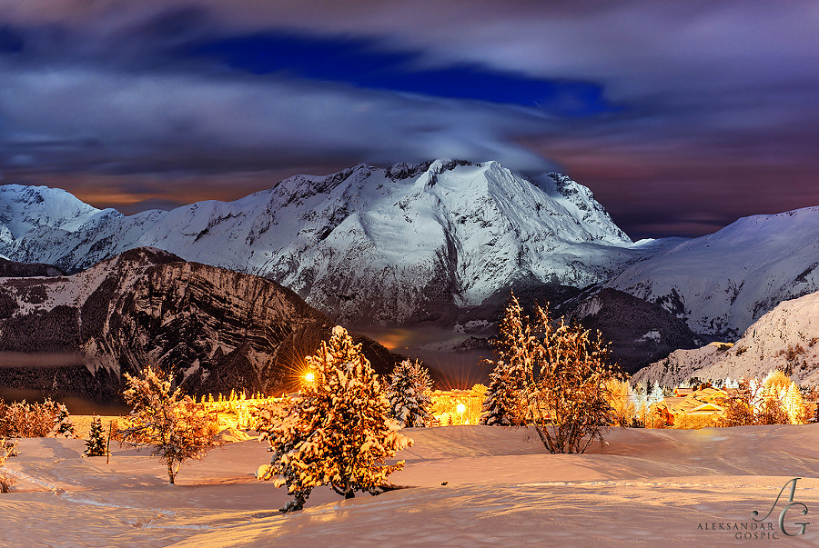 Moonlit night on the slopes above the legendary Alpe d'Huez resort in the French Rhone Alps, at the end of the heavy snowfall day