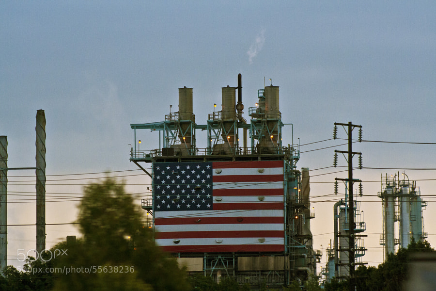 A USA flag on the exterior of oil refinery in Long Beach, California off the 405 freeway.    Watching the smog out of this refinery doesn't make me feel too patriotic though.
