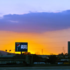 """An illuminating  """"Drink Pepsi"""" billboard glowing as the sun goes down in Long Beach, California.  This photo was captured while being driven on the 405 freeway."""