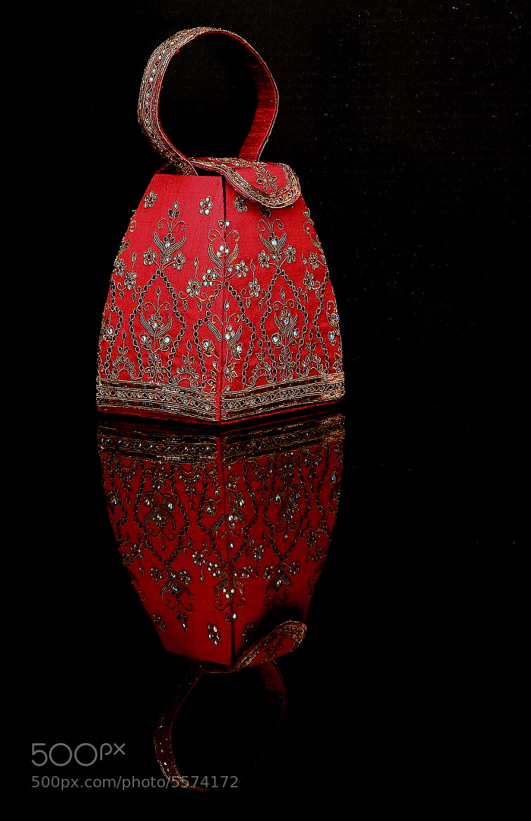 Photograph Red Handbag with Reflection by Sudeshna Das on 500px