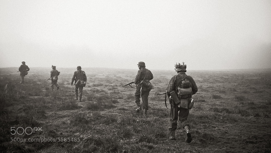 German Grenadiers move across foggy open fields.