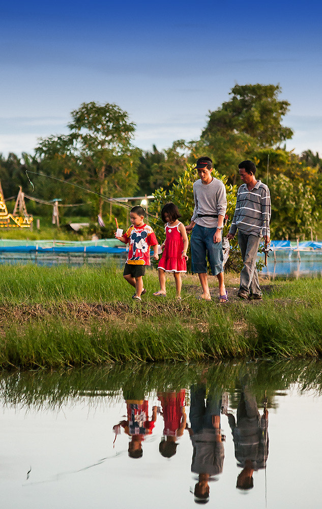 Photograph A Family and Reflection by Vorravut Thanareukchai on 500px