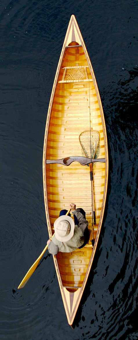 Photograph Fisherman in a wood canoe. by Sébastien Trudeau-Dion on 500px