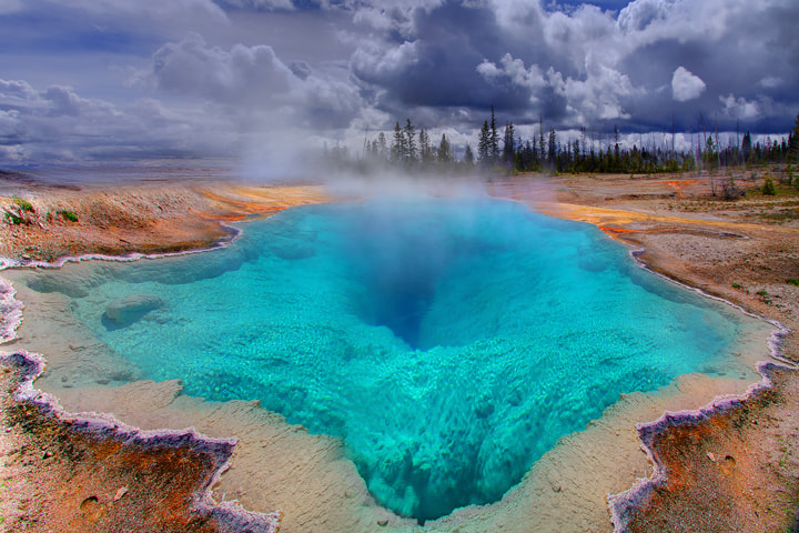 Photograph The Deep Blue Hole In Yellowstone by Kevin McNeal on 500px