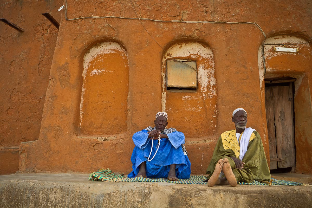Photograph two old men sitting on the old mosque of the village of segoukoro, near Segou, Mali by Anthony Pappone on 500px