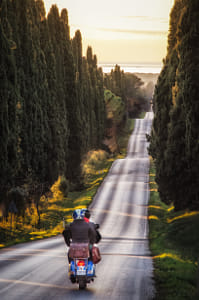 Riding a Vespa down Cypress Avenue in Bolgheri by Kimberly Potvin on 500px