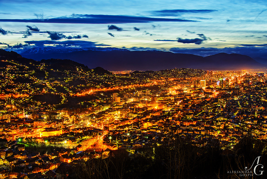 Twilight above the Sarajevo, shiny capital of Bosnia and Herzegovina, in the distance Igman and Bjelašnica (2064m) mountains rise