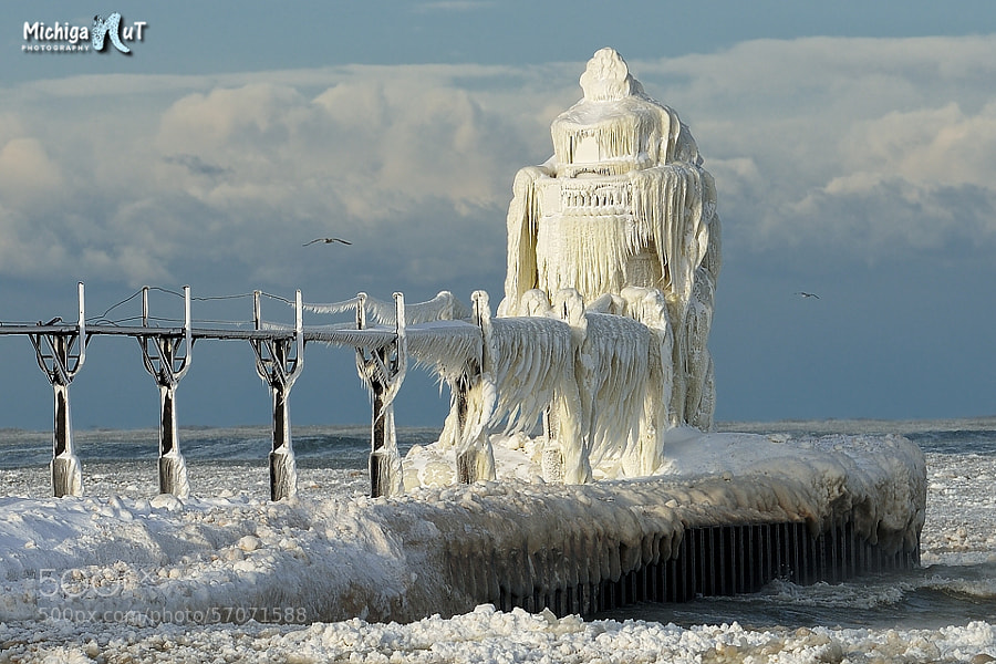 "Photograph ""Natures Art"" ice encased St. Joseph, Michigan Lighthouse by John McCormick on 500px"