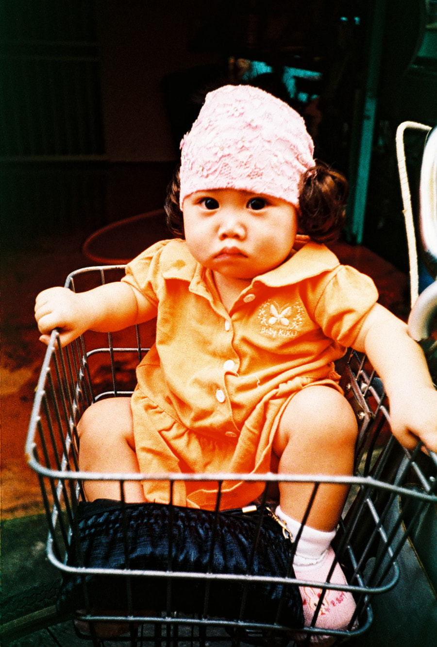 She was actually sitting in the basket which is placed in front of the bicycle. What a cute baby. At Crab Island, Selangor, Malaysia.