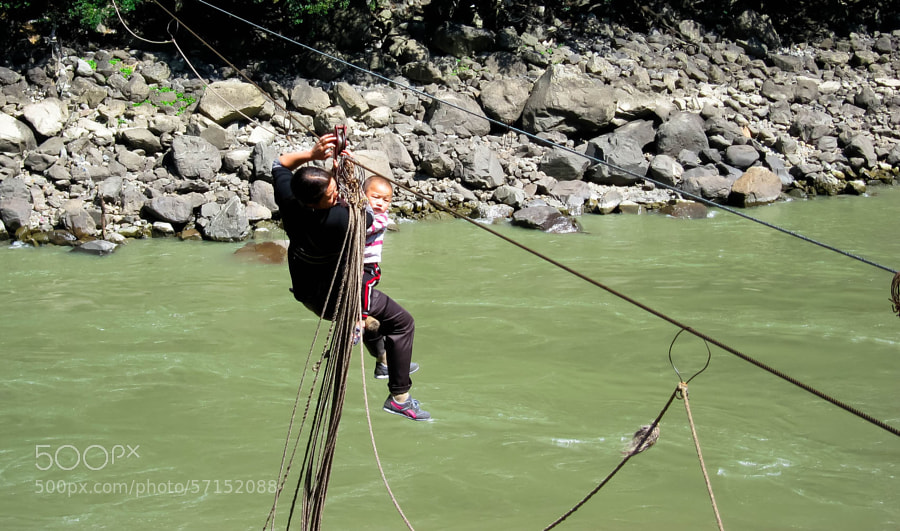 Photograph crossing river by zhangning  on 500px