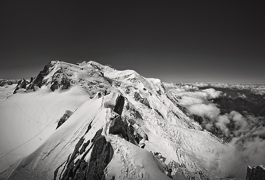 Mont Blanc shot from Aiguille du Midi. If you watch carefully, you can see the 2 climbers in the middle.  It´s a pan of 4 exposures merged in PS5.