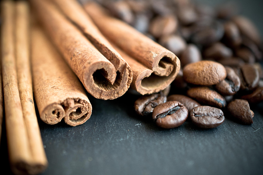 Coffee beans with cinnamon sticks by Athina Vassiliou on 500px.com