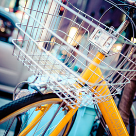 Close-up of a basket on one of the many bicycles parked along the streets of Tokyo