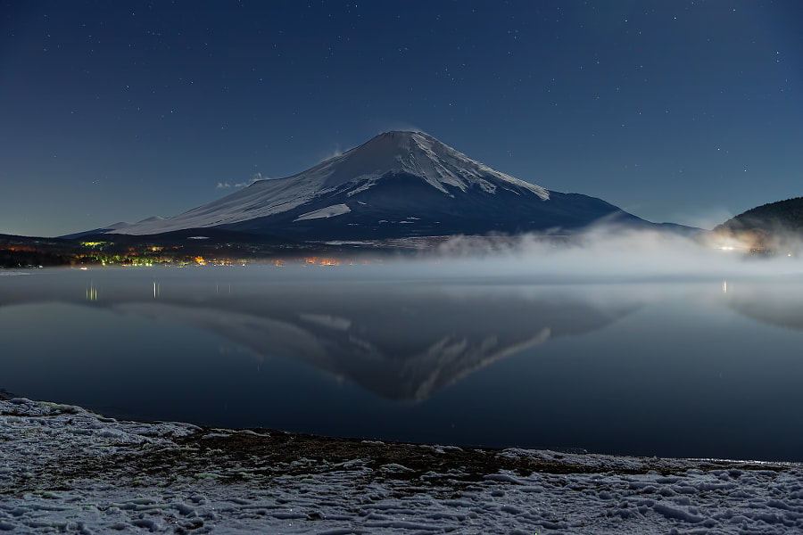 This place is lake Yamanaka in Yamanashi pref. Japan. I could take this photo because of no-wind and bright moonlight. (taken at 11:59 PM) It was so cold condition. (temp. was -17 deg.C)