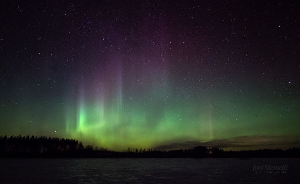 Photograph Wall Of Northern Lights by Joni Niemelä on 500px