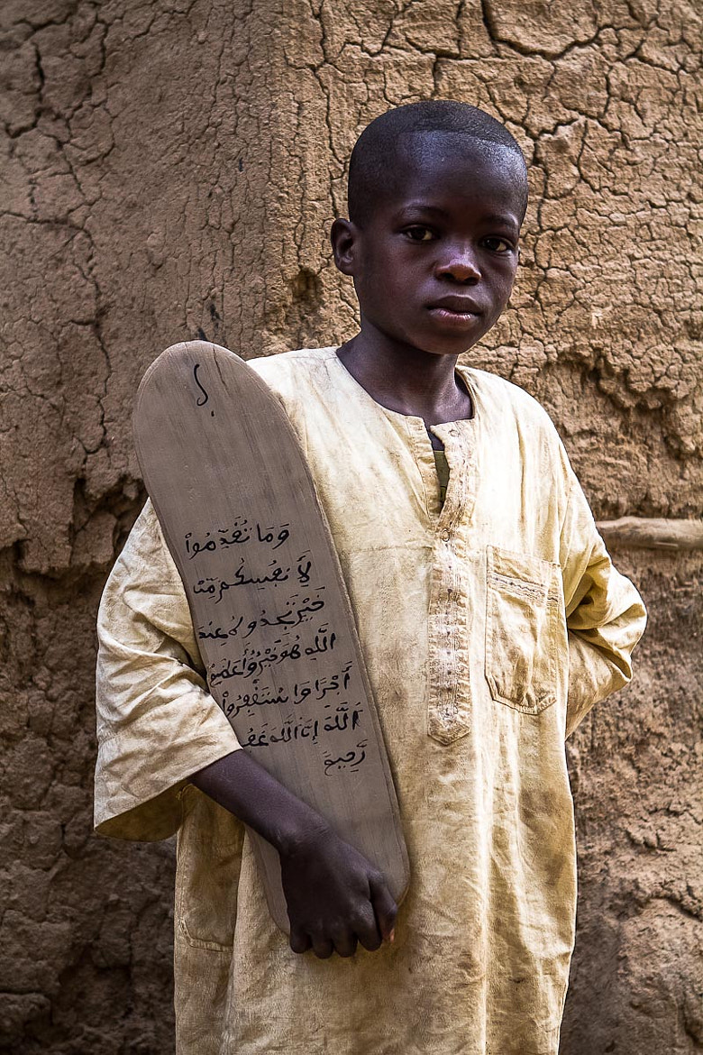 Photograph child with praying board  by Anthony Pappone on 500px