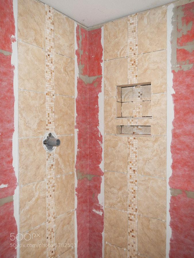 installer le mur de douche de tuile