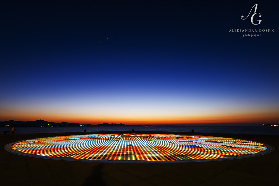 Conjunction of Jupiter and Venus in the western twilight sky behind Zadar's Greeting to the Sun installation, which never sets