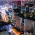 The streets and buildings of Tokyo glow with light after sundown.