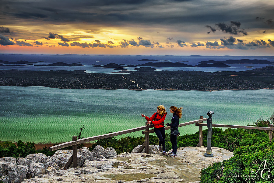 On the south wind overlooking the Vrana Lake. At the back is Adriatic Sea and islands under the clouds of the incoming low pressure