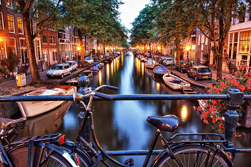 Photograph Bicycle and Canal at Dusk by Rich Voninski on 500px