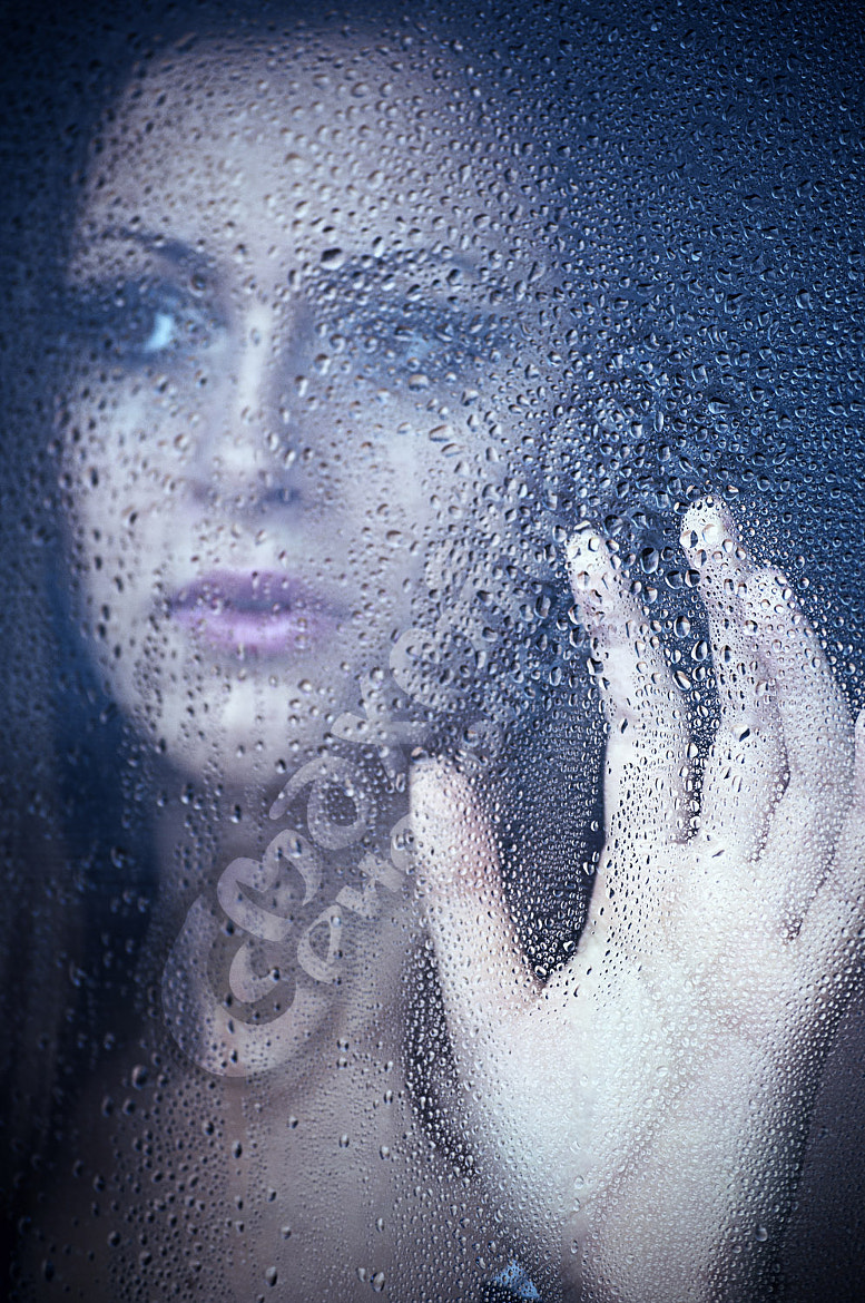 Photograph a girl watching through the window after a rain. Portrait. by Mihai Maxim on 500px