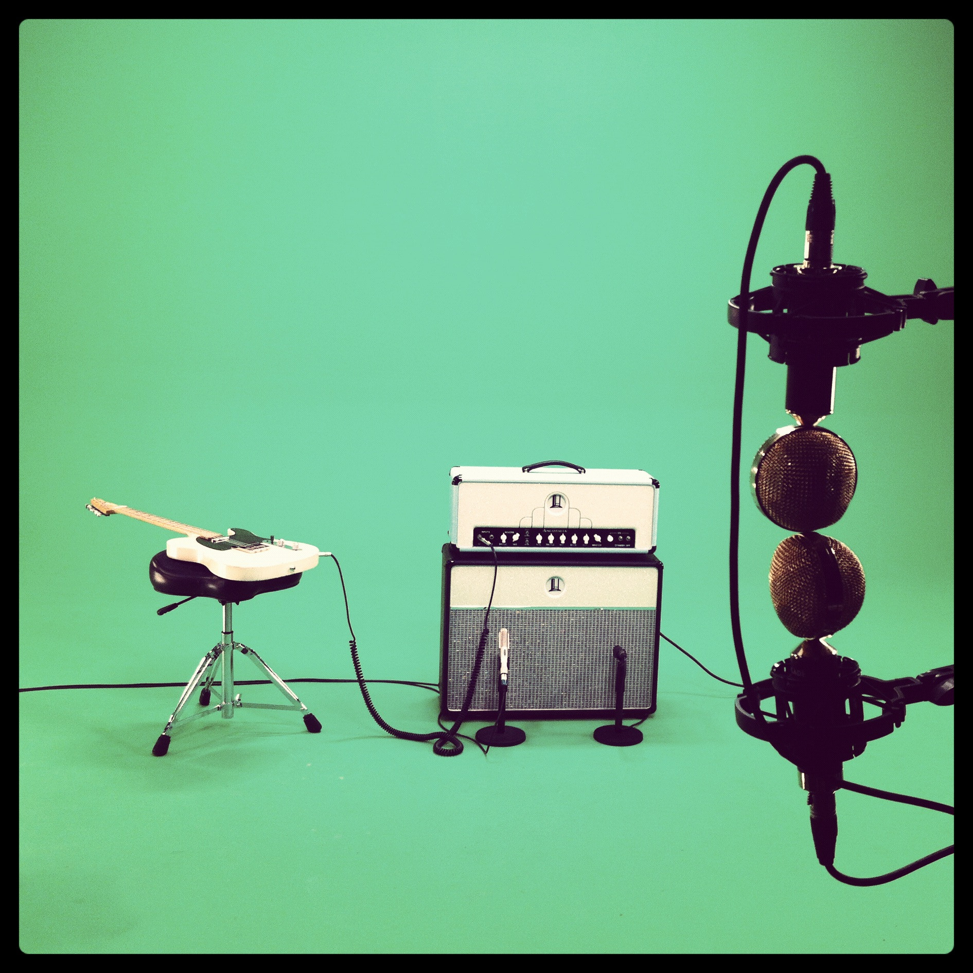 Photograph Guitar, amp and mics on the green screen by David Leclerc on 500px