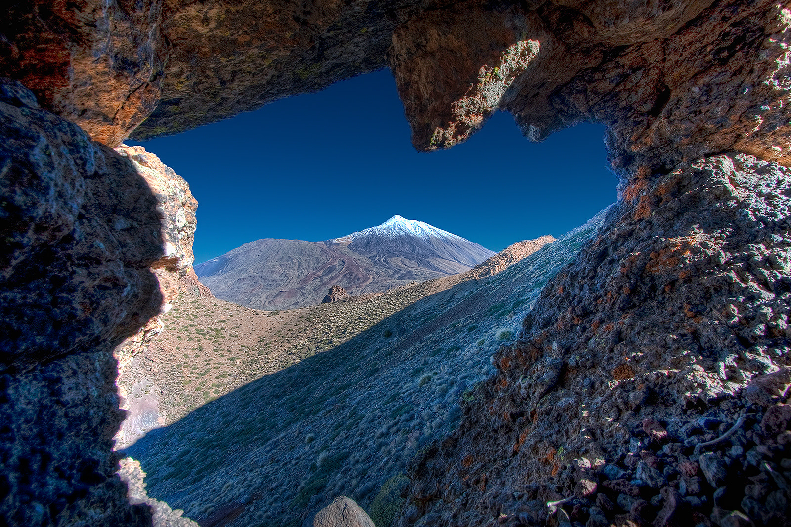 Photograph Mt. Teide through rock archway by Michael Bolognesi on 500px