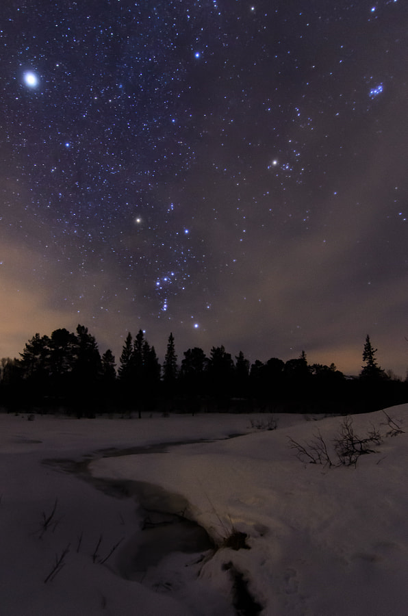 Orion, a creek, snow and some clouds