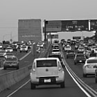 The 405 freeway at rush hour as traffic is building up.