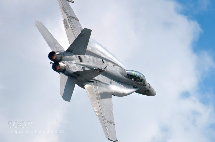 F/A-18F Super Hornet of the US Navy TAC Demo team performs over Columbus, GA at the 2012 Thunder In The Valley Airshow