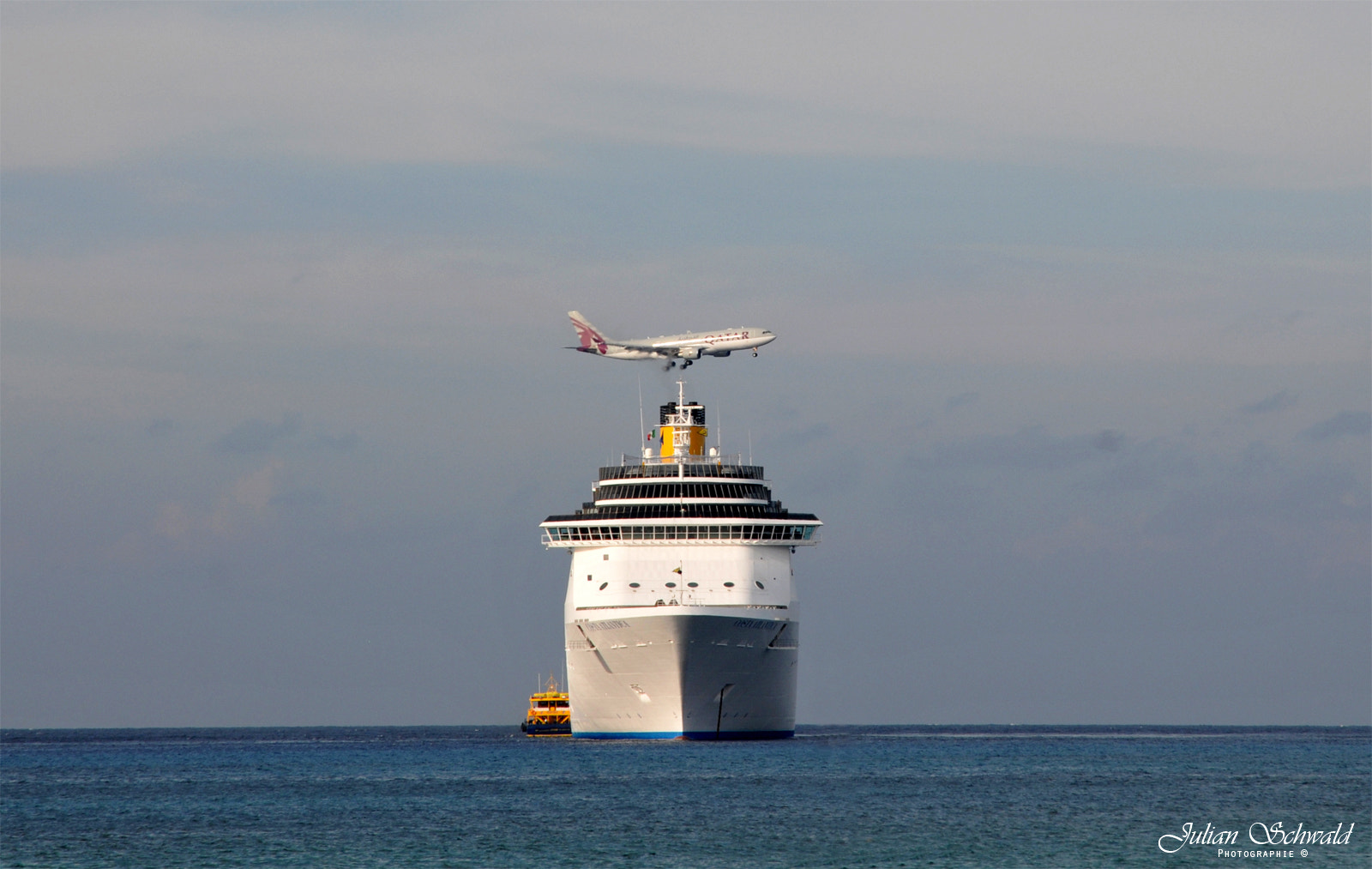Photograph Cruise Ship vs. Aircraft by Julian Schwald on 500px