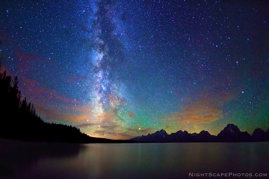 """Starry night sky and Milky Way over Jackson Lake and Tetons, Grand Teton National Park.  Virtually all my NightScapes are ONE exposure (less than 30 seconds), and with very little Photoshop correction. For more how-to and behind the scenes information, visit my <a href=""""http://intothenightphoto.blogspot.com/"""">Into The Night Photography</a> blog. For Milky Way photography workshops, visit my <a href=""""http://intothenightphoto.blogspot.com/2013/11/royce-bairs-2014-photography-workshop.html"""">NightScape Events</a> page. You can <a href=""""http://roycebair.smugmug.com/Personal-Work/Nightscapes/"""">order PRINTS here</a>."""