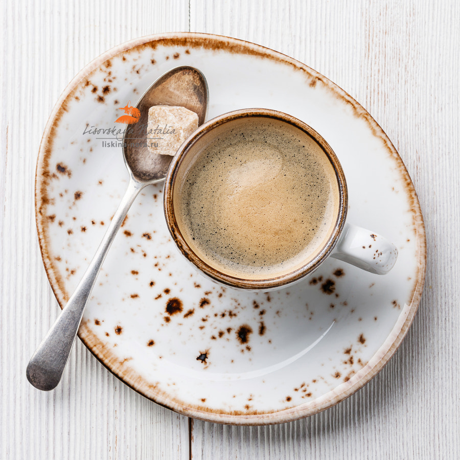 Espresso cup on white wooden background