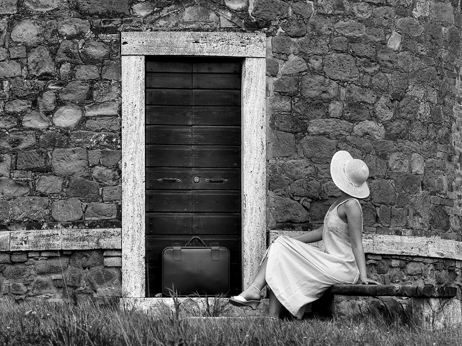 Photograph A lady with a suitcase by Janez Tolar on 500px