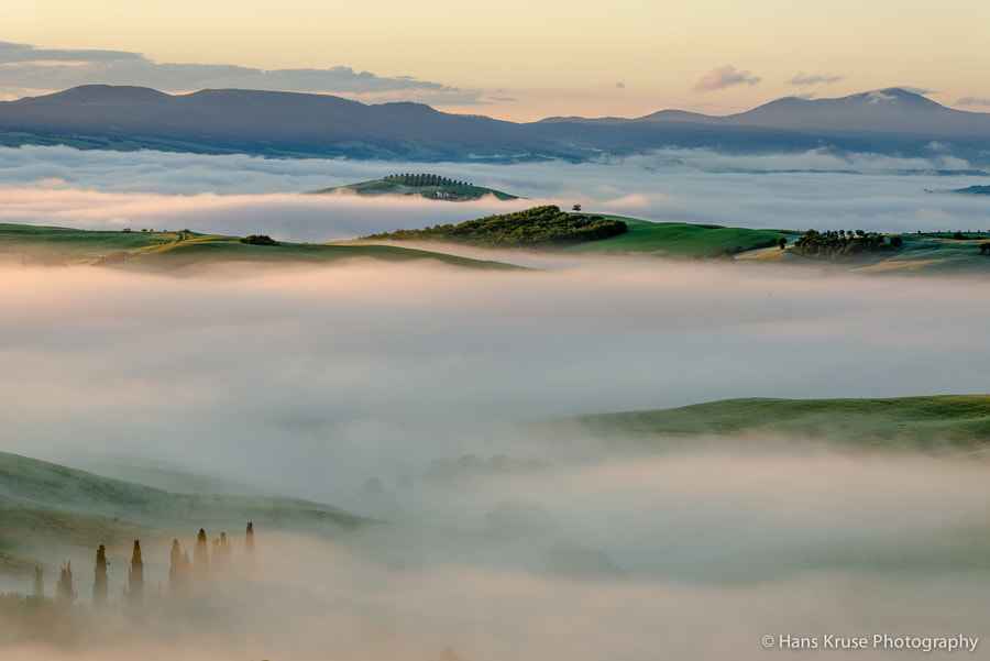 This photo was shot during the Tuscany May 2013 photo workshop on a beautiful morning with fog and green colors. The Tuscany photo workshop in May 2014 is sold out, but there is a Tuscany November 2014 photo workshop with available seats. Check my homepage under about for details.