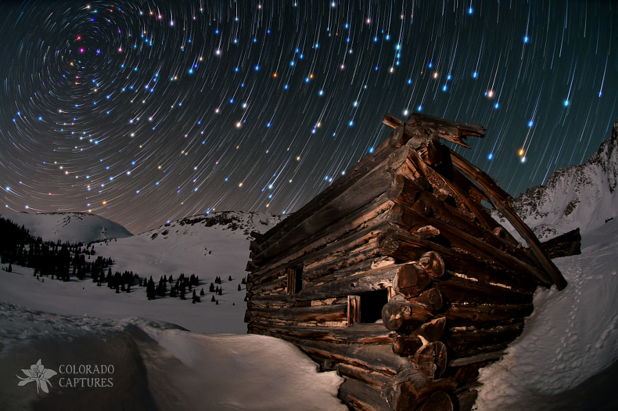 """I did another snowshoe trek up to Mayflower Gulch with friends Jon Blake and David Kingham that was dark and cold but still a lot of fun.  And while I didn't come away with any new shots I really liked, I left anxious to try David's tutorial on <a href=""""http://kinghamphotography.com/2011/12/11/comet-like-star-trails/"""" target=""""_blank"""">Comet-Like Star Trail Processing</a>.  So here's a reprocessed composite image from a hike I did to the same location last May."""