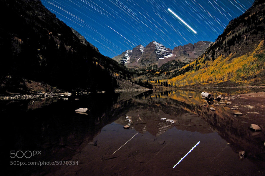 Aspen leaves shine bright while the planet Jupiter streaks across the night-time sky.  With clear skies and a partial moon, I decided it was time to go for a unique approach with my first visit to the Maroon Bells - one capturing the streaking stars over the peaks.  The amazing lighting and active wildlife made this an incredible experience - one I highly recommend.  This image comes from 15 - 3 minute exposures taken from Maroon Lake above the town of Aspen, Colorado.