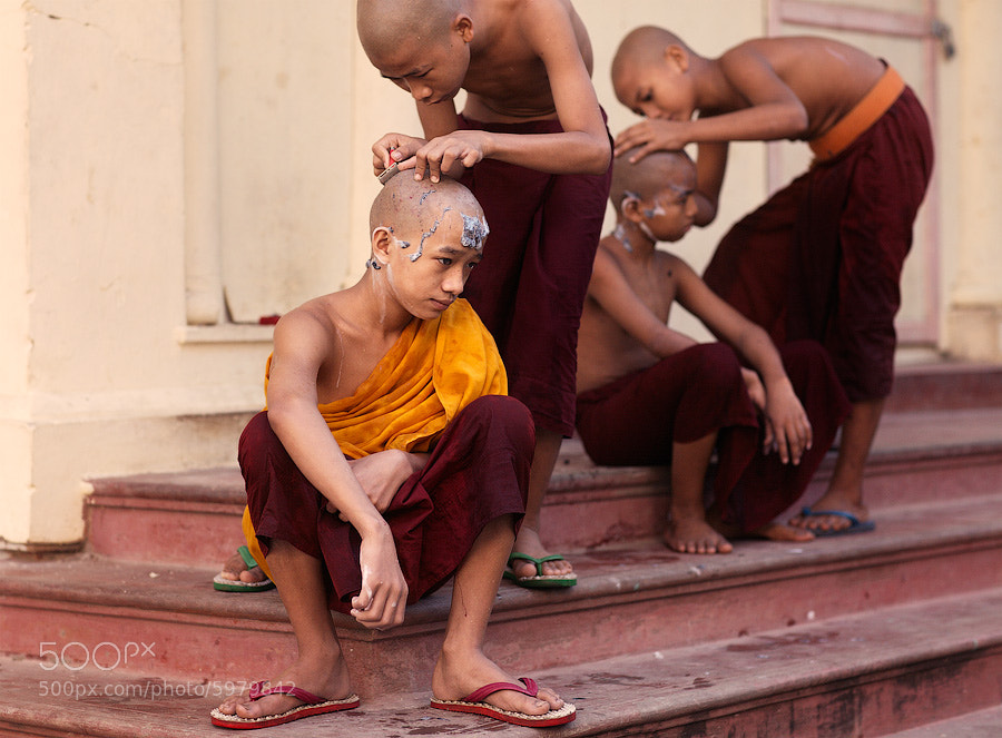 Photograph Young monks shaving by Dmitry Sumin on 500px