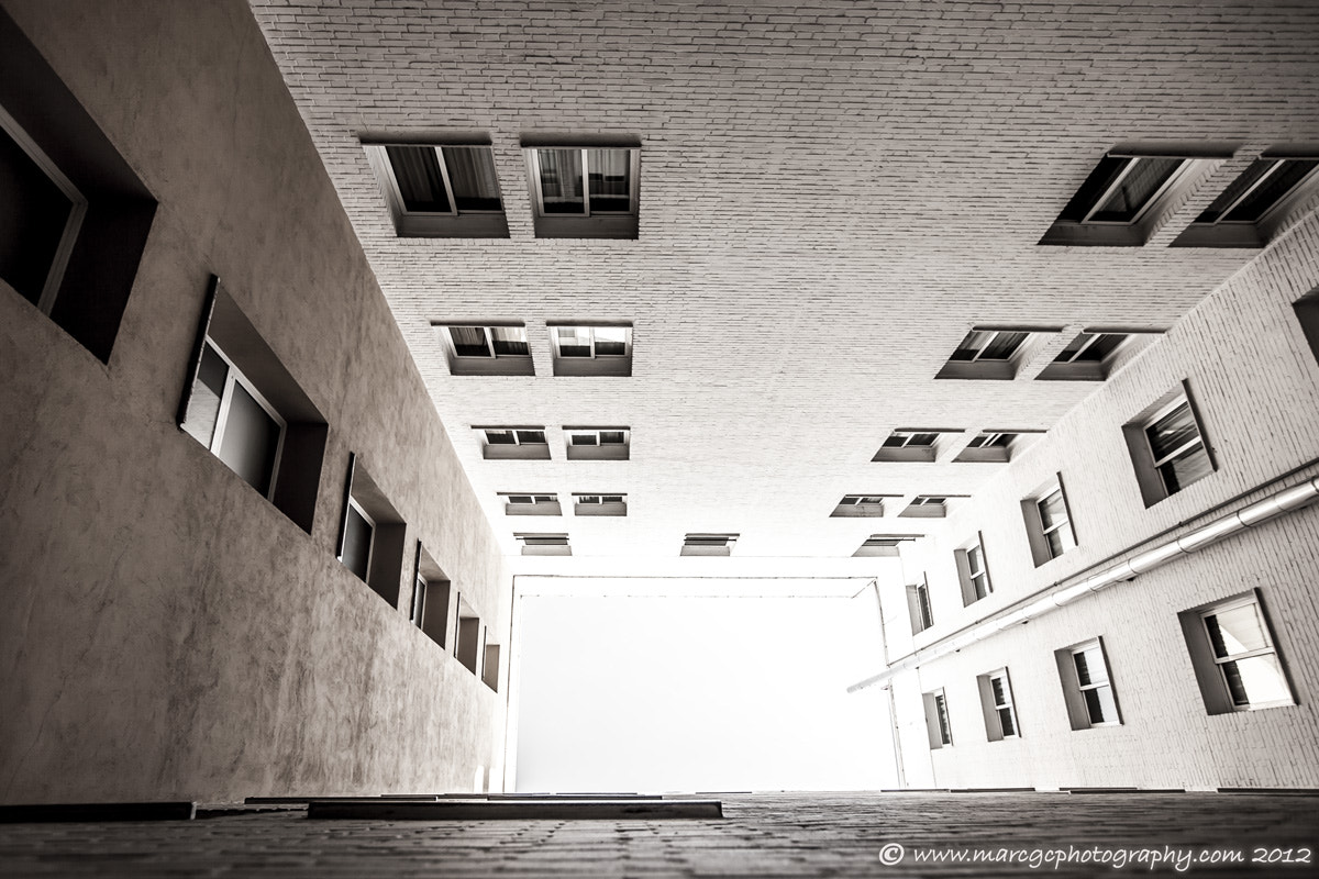 Photograph Tunnel Between Buildings by Marc Garrido on 500px