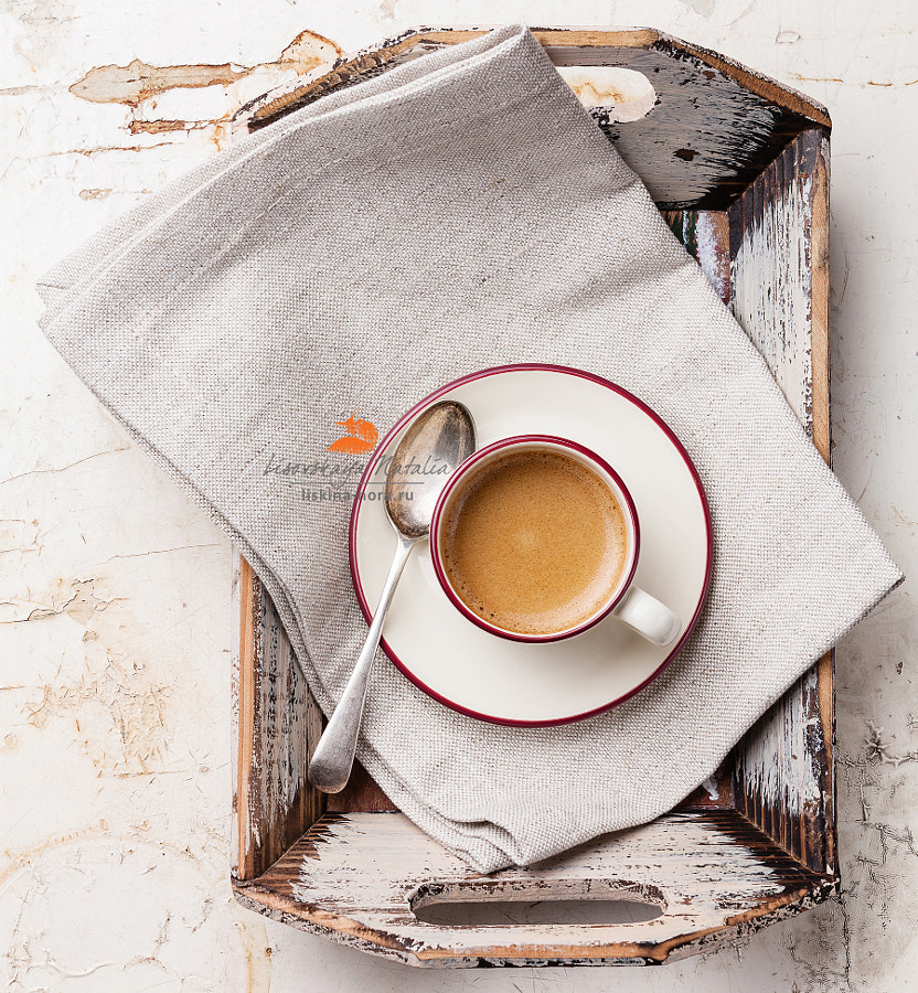 Coffee cup in Vintage tray on beige background