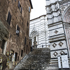 Backdoor and stairs to duomo of Siena