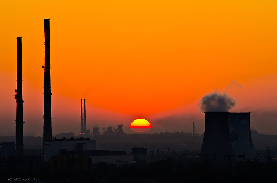 Sunrise and industrial chimneys