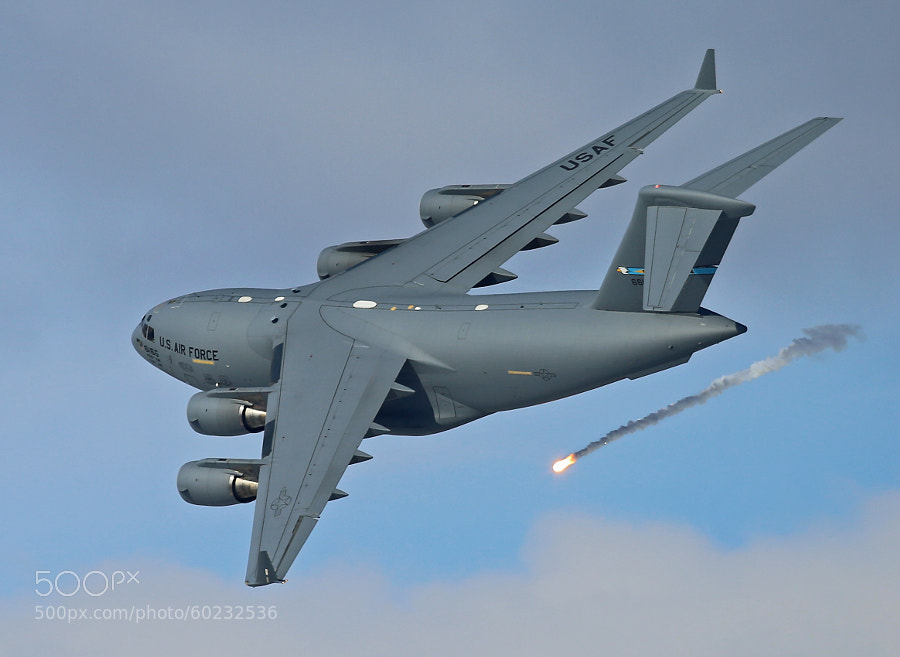 C-17 Globemaster III pops a flare and takes evasive action to avoid a SAM, Surface to Air Threat.