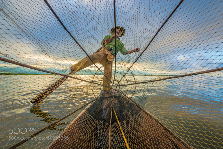 Photograph Fish Hunter also known as Leg Rower by Zay Yar Lin on 500px