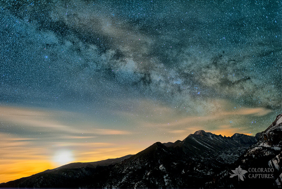The Milky Way dominates the sky in this stunning view from Rocky Mountain National Park near Estes Park, Colorado.  This multiple exposure composite image features natural foreground illumination coming from a thin moon shown in the bottom left with clouds lit up from the front range light pollution.  Between the Milky Way, the Moon, and the glowing clouds, it sure made for an incredible early morning view looking up into Glacier Gorge at Longs Peak.