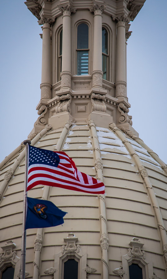 The Michigan Capitol Dome with the U.S. and Michigan flags, Lansing.